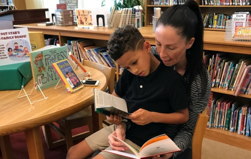 Parent Volunteers Make Family Library Time Possible